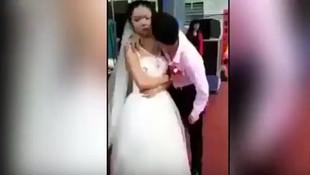 Düğünde eşini öpmek isteyen damat rezil oldu