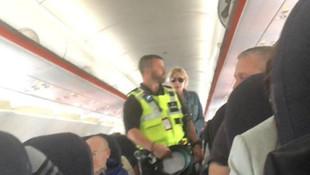 Uçağın tuvaletinde yakalandı ! Polis indirdi...