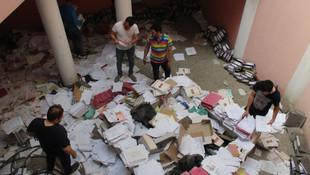 Muhasebeci evrakları yere saçtı, mağdurlar belge aradı