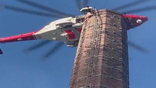 88 metredeki bacada baş aşağı asılı kaldı