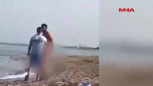 Plajda çıplak gezen adama meydan dayağı !