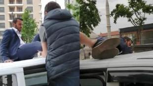 UBER sürücüsü soluğu aracın tavanında aldı