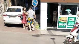 Erkek arkadaşına sokak ortasında kafa attı