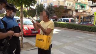 Maske takmadığı için ceza kesen polise beddua etti