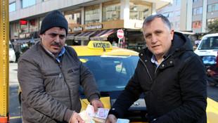 Taksisinde unutulan 70 bin lirayı sahibine teslim etti