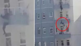 Balkondan atlayan kocasını son anda yakaladı ama kurtaramadı