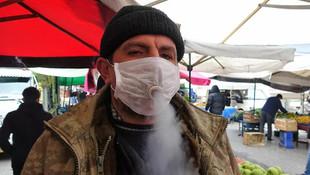 Sigara tiryakisi vatandaşın coronavirüs maskesi pes dedirtti!