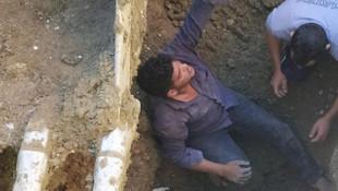 Toprak altında kalan işçi güçlükle kurtarıldı