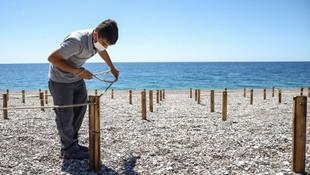 Türkiye'nin tatil cenneti plajında deniz keyfine koronavirüs ayarı