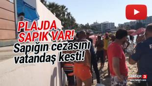 Plaj sapığına cezasını vatandaş kesti!