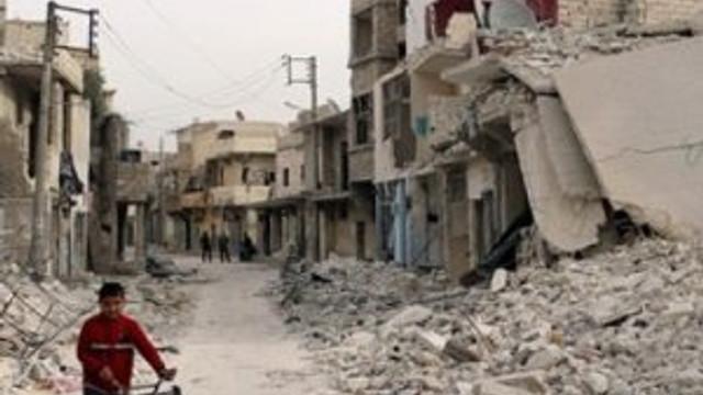 Halep'e 'paraşütlü bombalarla' saldırı: 11 ölü, 25 yaralı