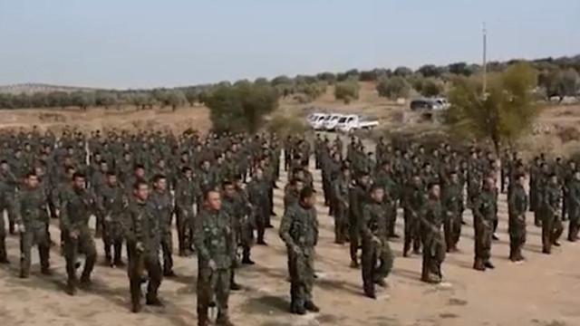 ABD'nin eğittiği teröristler yemin töreninde görüntülendi