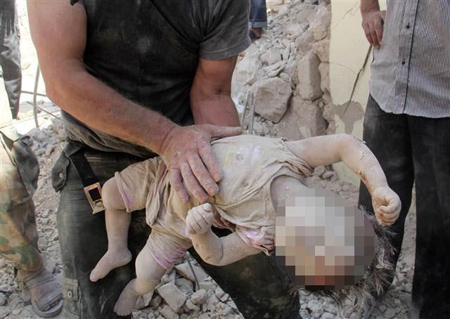Suriye'de Esad varil bombasıyla vurdu