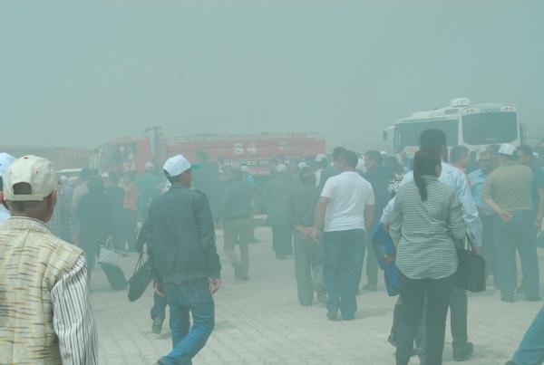 Yangın tatbikatı izleyen Bakan duman yutup ıslandı