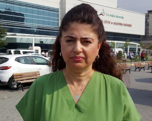 Tutuklanan albayın eşi darbe protestosunda