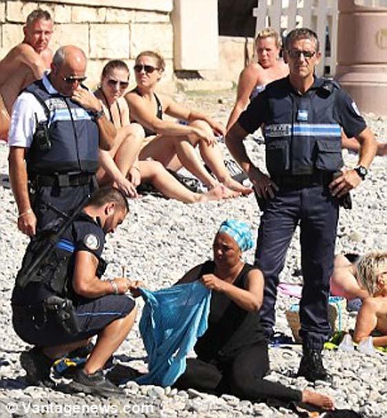 Plajda skandal ! Polis zorla çıkardı...
