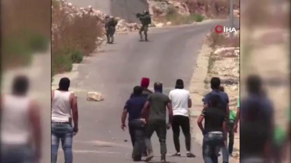 Filistinli gençler İsrail askerini böyle püskürttü