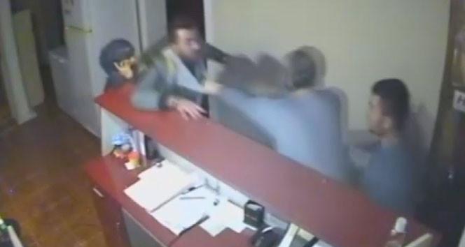 Otelde karı koca işletmeciye dayak kamerada