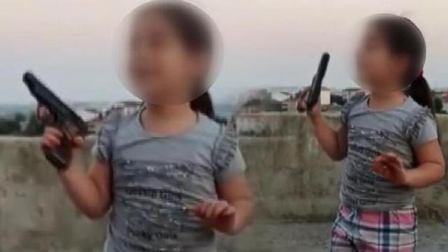 6 yaşındaki çocuğa silahla ateş ettirdiler!