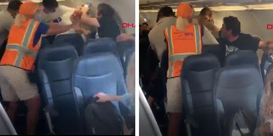 Yolcu uçağında tekme tokat maske kavgası kamerada