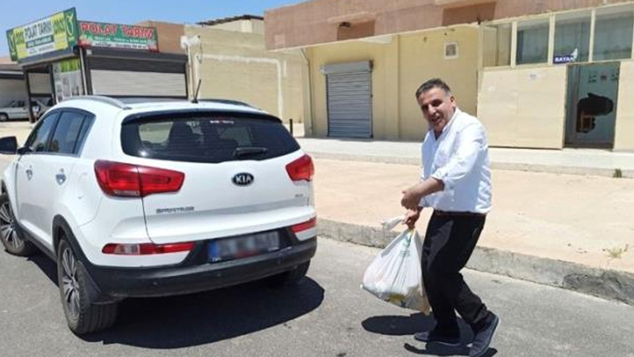 Kooperatif başkanı lüks aracıyla gelip, gıda yardımı aldı