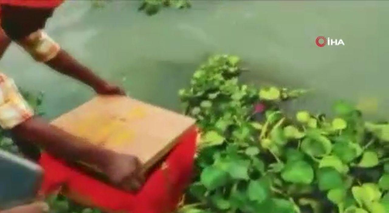 Nehirde yüzen sandığı açınca gözlerine inanamadılar - Resim: 3