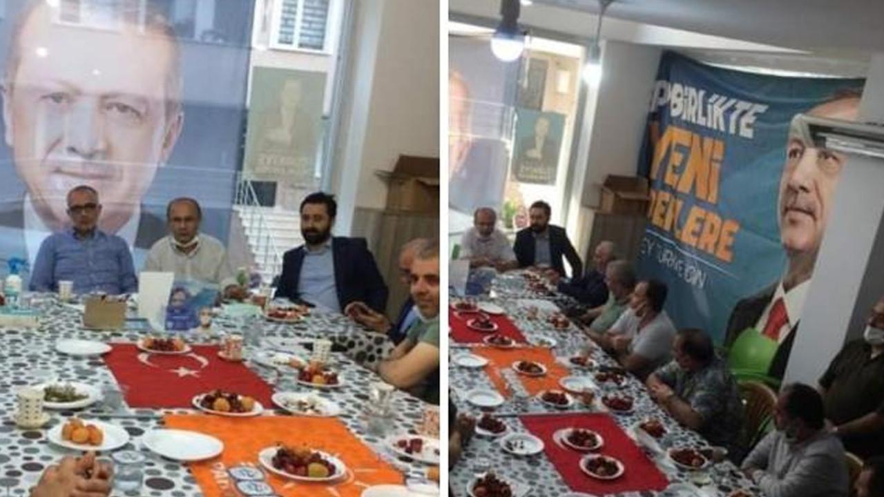 Türk bayrağı üzerinde yemek yiyen AK Partililere tepki yağdı