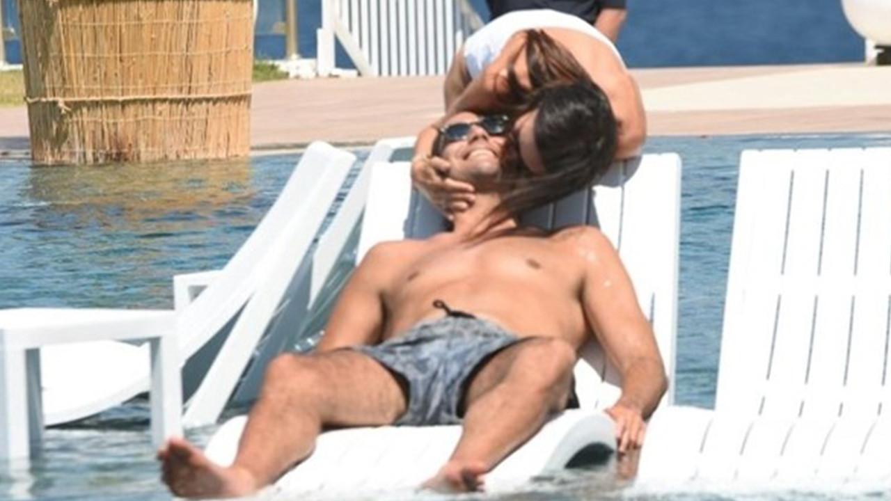 Ünlü çiftin havuz başı romantizmi! Öpücüklere boğdu