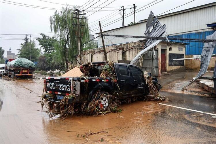 Çin'de su baskını nedeniyle tünelde mahsur kalan 14 işçinin cesedi bulund - Resim: 2