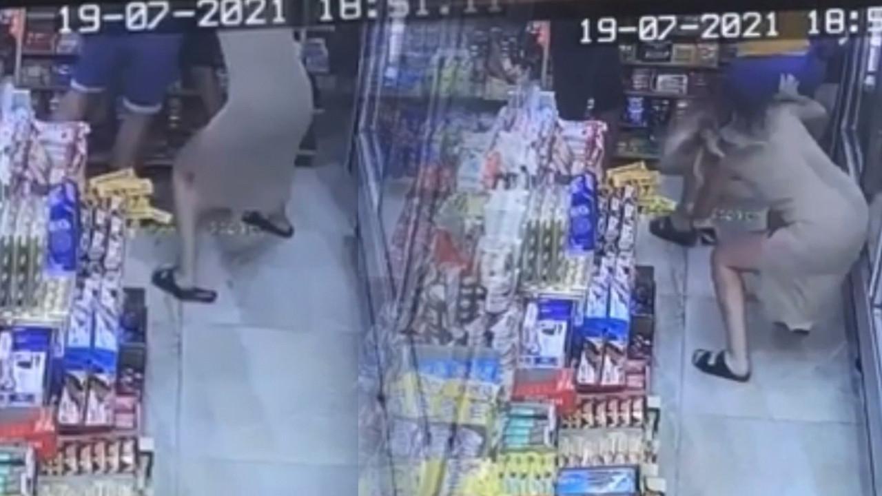Markette eşini taciz eden sapığı yere serdi